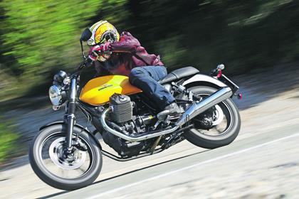 Moto Guzzi V7 Stone side profile riding shot