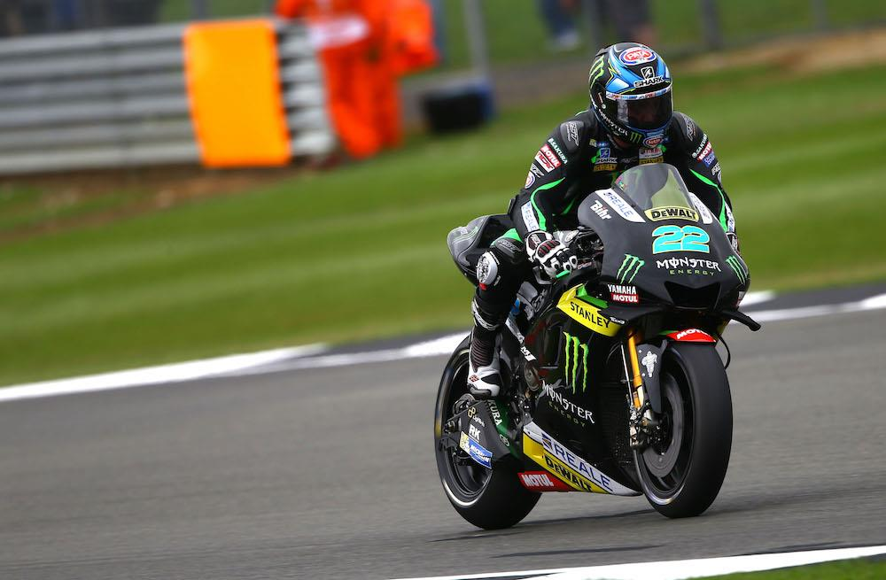 Alex Lowes checking the number on the front of his bike Racing