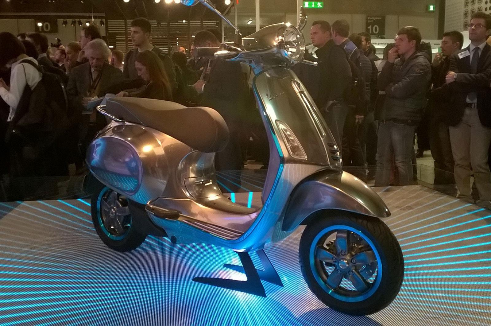 Vespa shock Milan with Elettrica scooter
