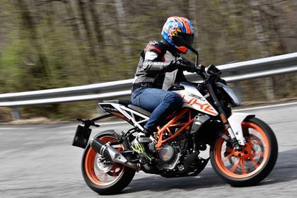 KTM 390 Duke side profile riding shot