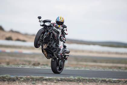 Triumph Speed Triple RS pulling a massive wheelie