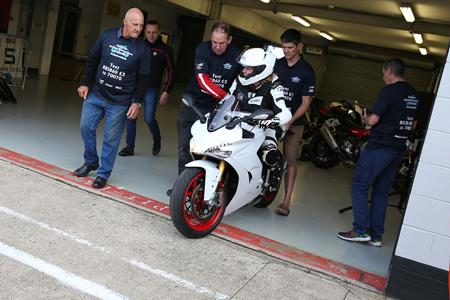 Paralysed fundraiser completes a lap of Silverstone at the