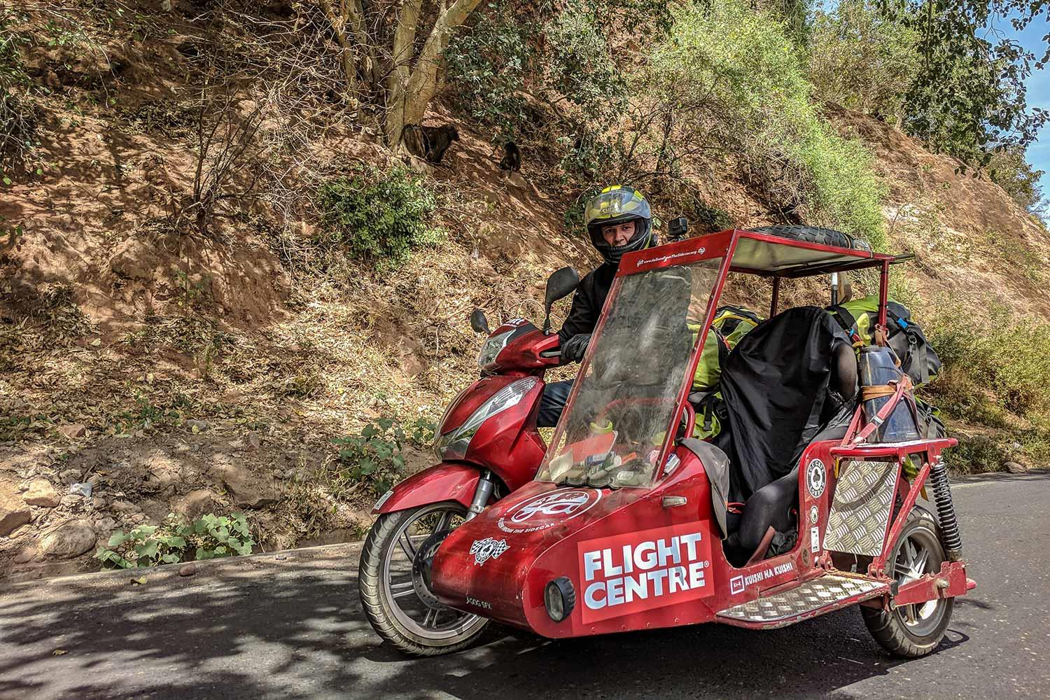 Video: R5K members lap the world on a shed-built scooter sidecar