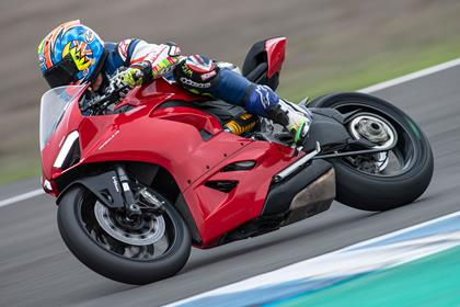 Ducati Panigale V2 cornering knee down high zoom side profile