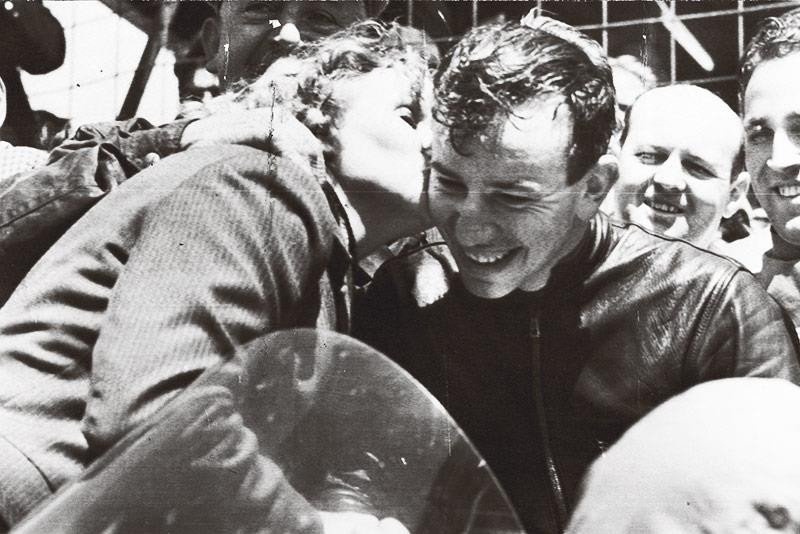 John Surtees gets a kiss from his mother after his first TT win