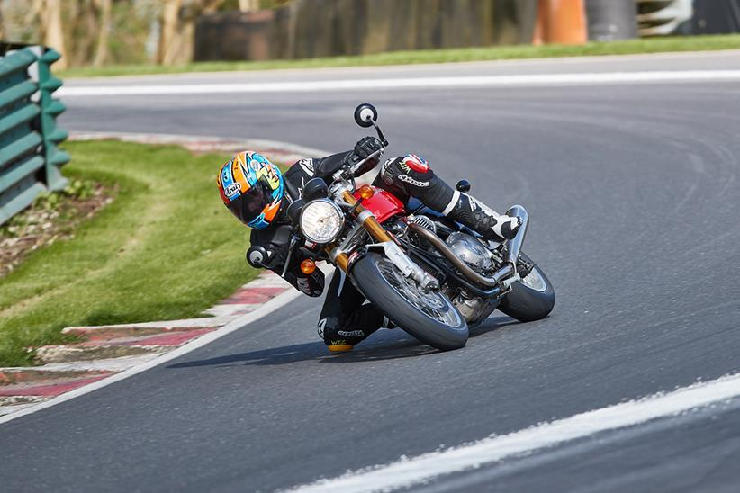 Triumph Thruxton R cornering hard on track with knee down