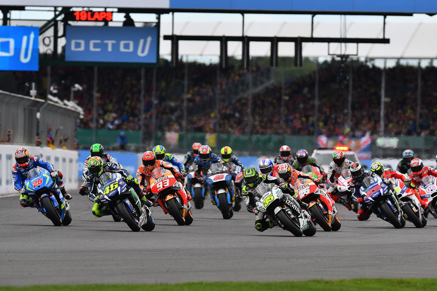 Motorcycling-Dovizioso takes MotoGP lead with British GP win