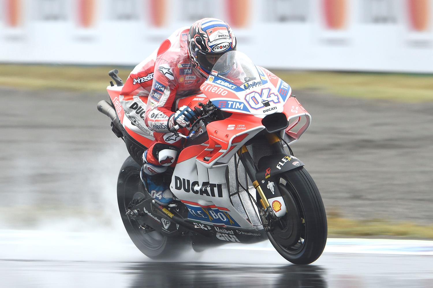 Dovizioso defeats Marquez in wet MotoGP epic