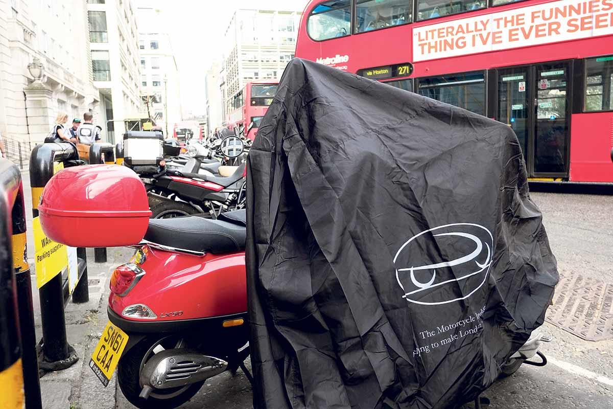Free motorbike covers handed out in London