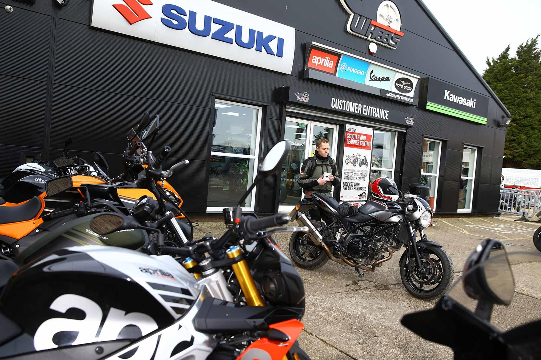 Dan looks over the Suzuki SV650X with a coffee