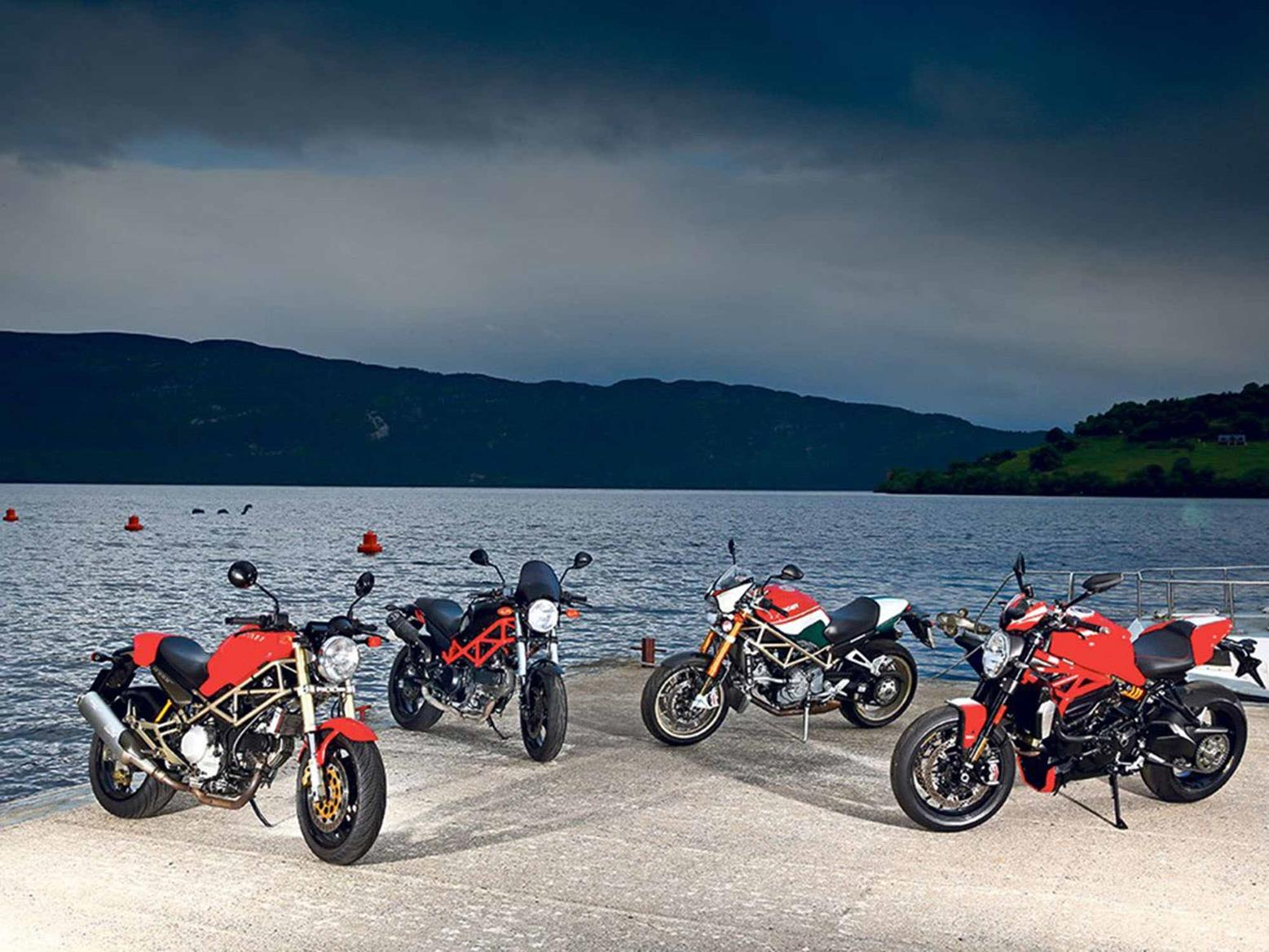 A variety of Ducati Monsters from history