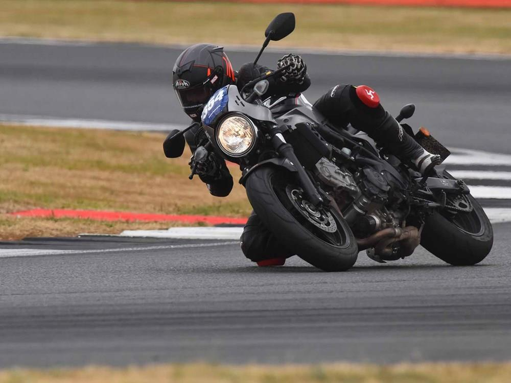 MCN's Dan Sutherland gets his knee down at Silverstone