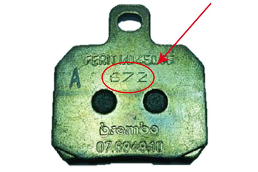 The affected brake pads have the number '672' etched on them