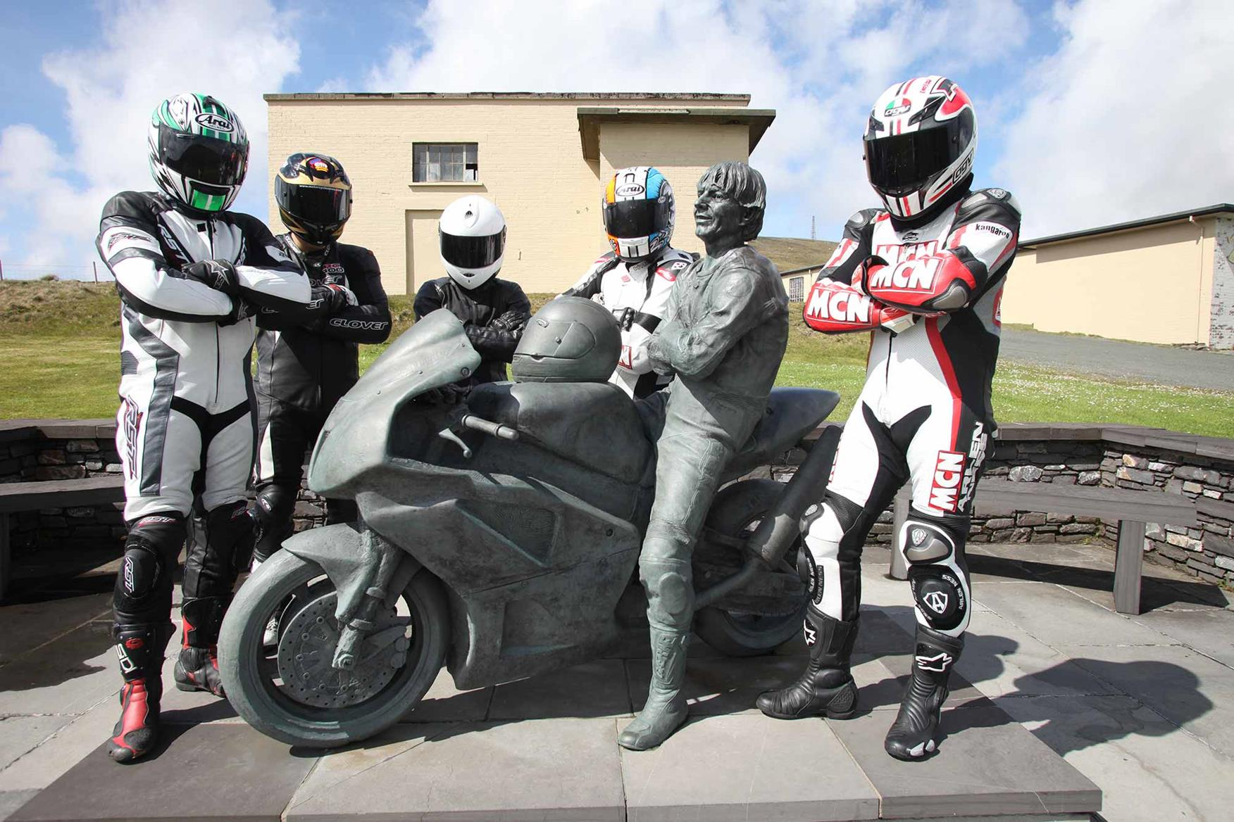 MCN road testers visit the Joey Dunlop statue on the Isle of Man