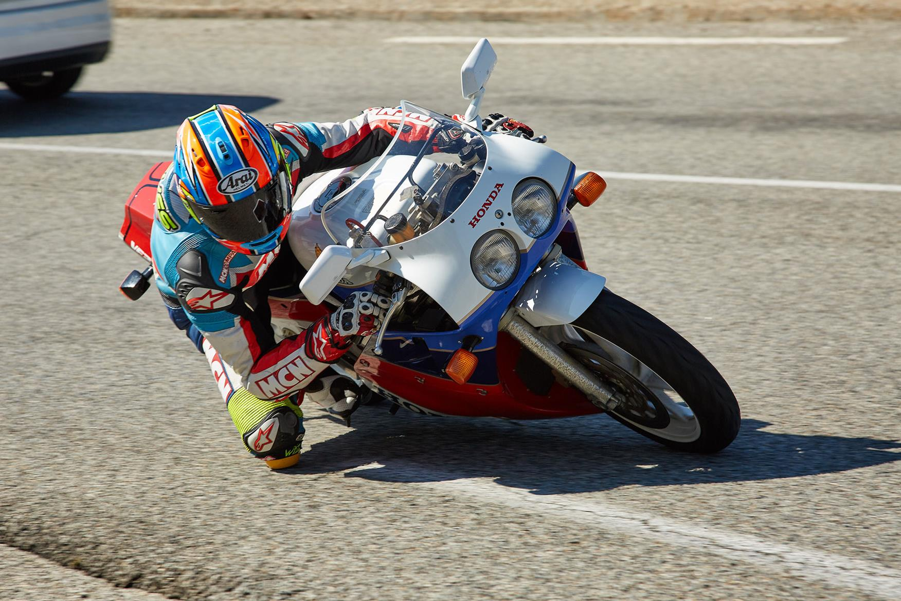 Chief Road Tester Michael Neeves testing a Honda RC30