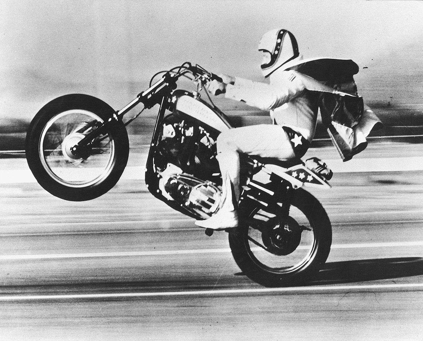 Evel Knievel wheelies his own H-D XR750