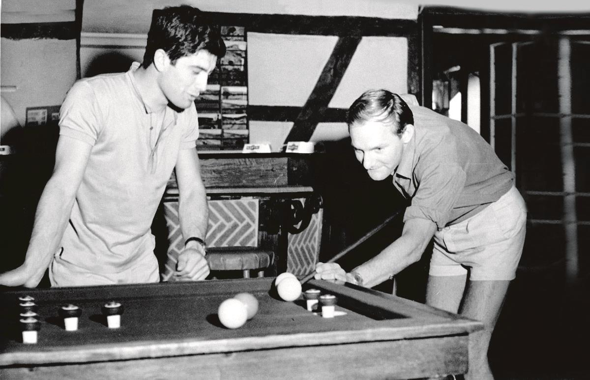 Mike Hailwood teaching Ago the finer points of bar billiards in 1965