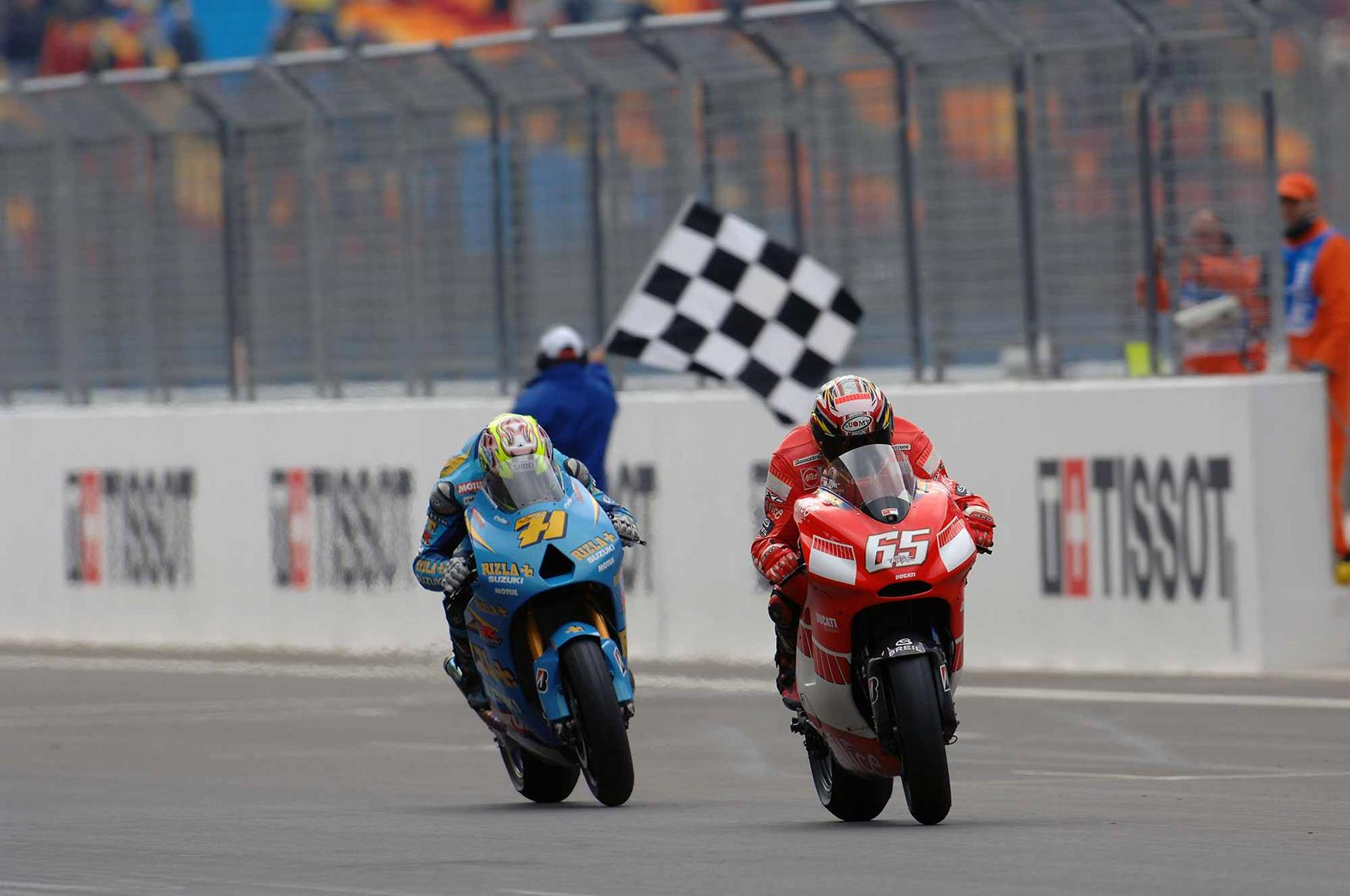 Following the Ducati of Capirossi across the line