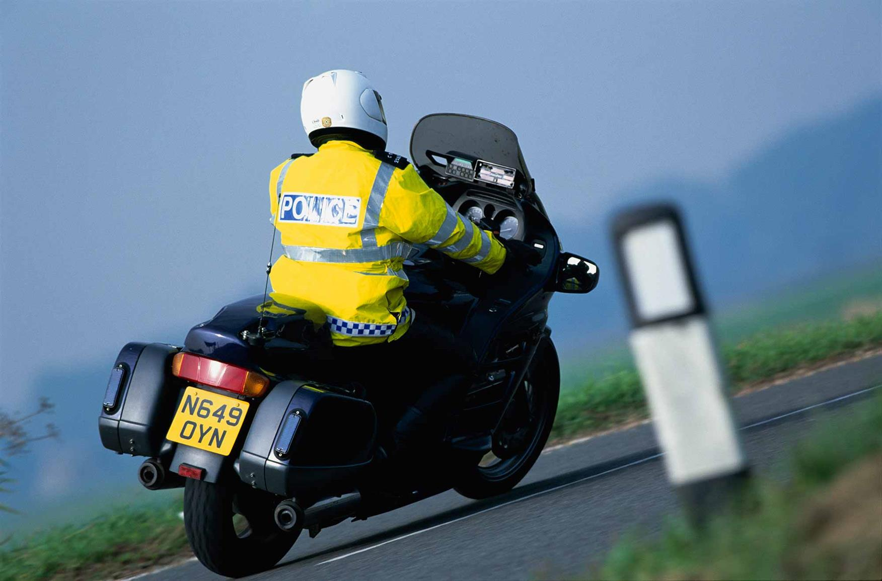 A police motorcyclist in action