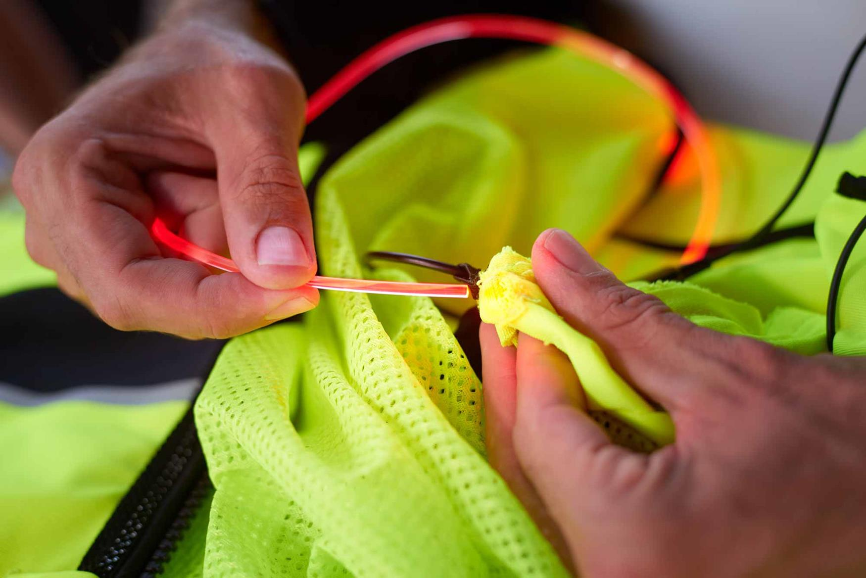 Feed the LED tubes through pockets in the garment
