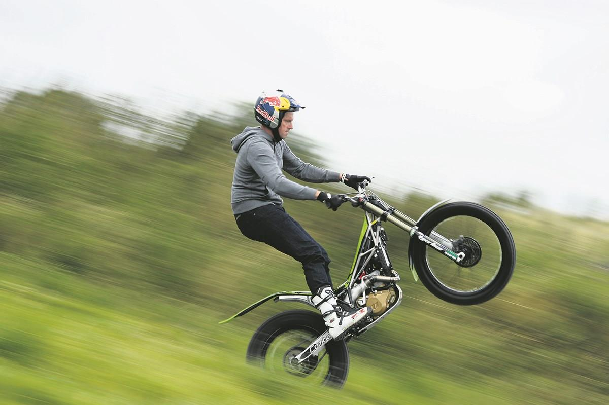 Lampkin pulls a wheelie on a Vertigo trials bike