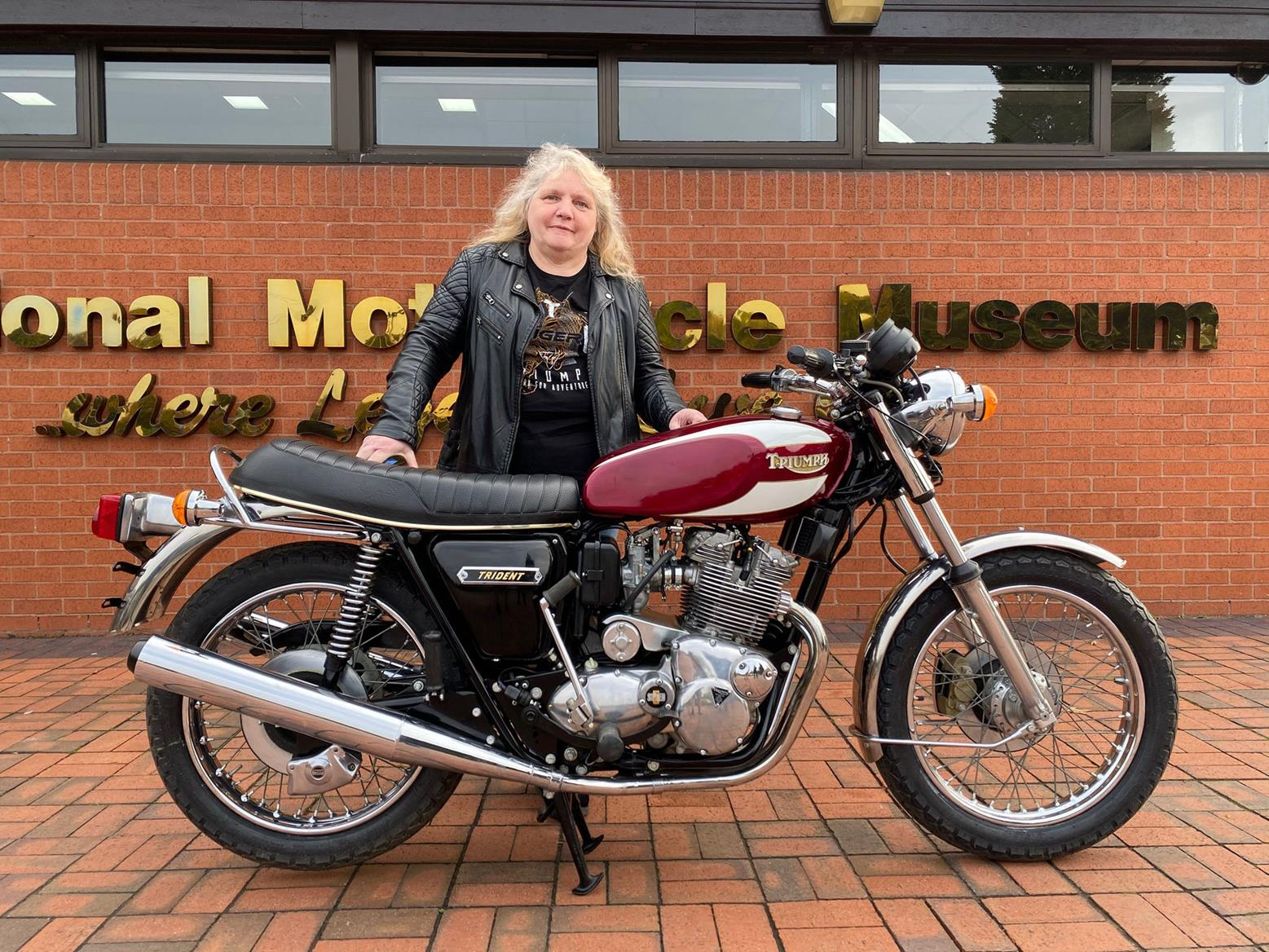 Mrs Sally Peace collects her Triumph Trident raffle prize