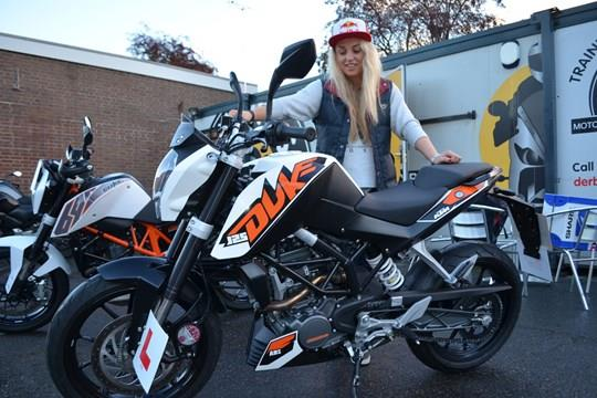 Aimee learning to ride a motorbike with KTM