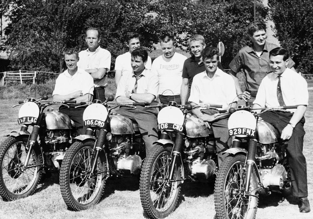 Steve McQueen (centre) with a fleet of Triumphs