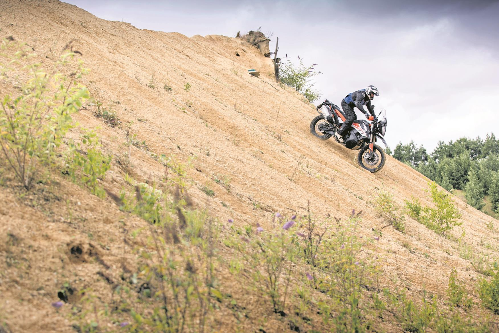 Heading down hill off-road aboard the KTM 790 Adventure R