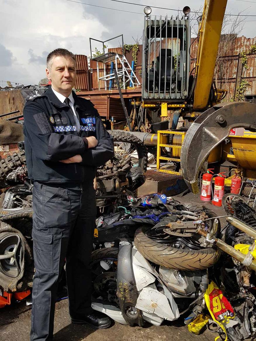 Chief Insp. Hadley with the remains of one of the crushed machines