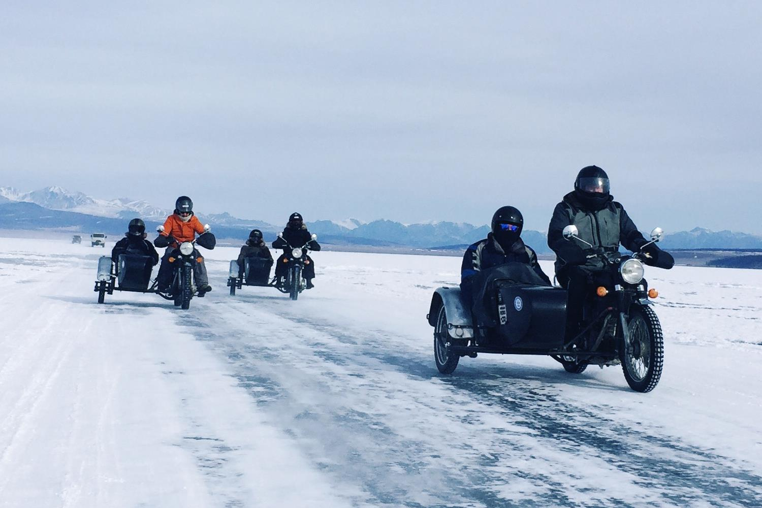 Motorbikes and sidecars on the frozen lakes of Mongolia