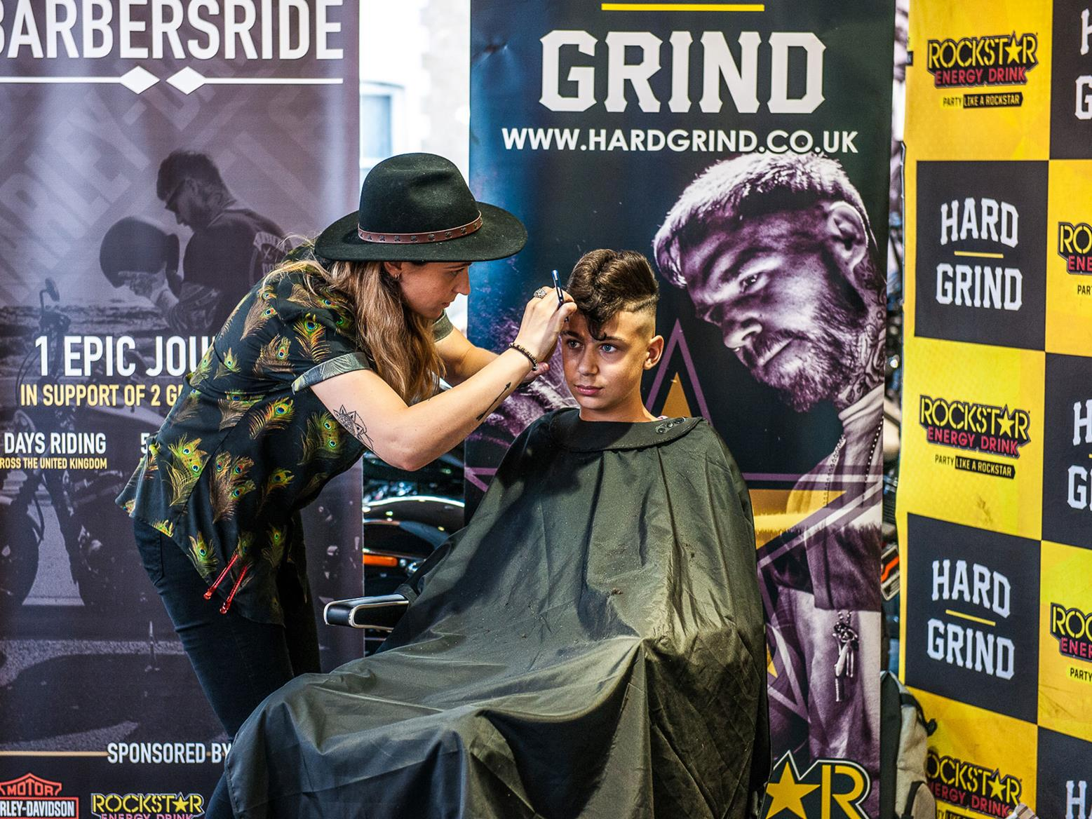 A barber trimming a haircut at BarbersRide