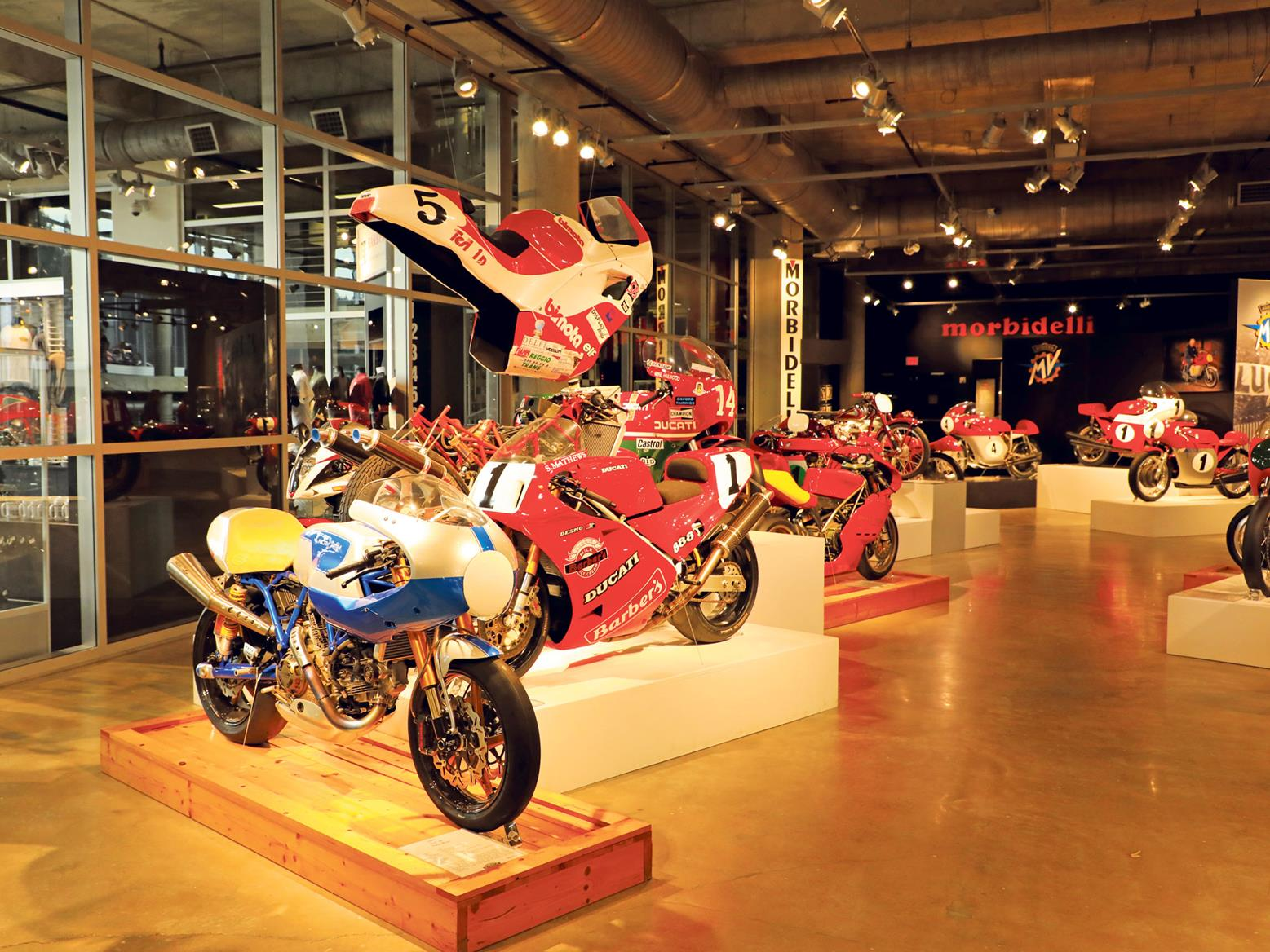 An ultra-rare NCR 'New Blue' sits alongside a Ducati 888 Corse and a Bimota Tesi 1D superbike with its bodywork hung like an exploded diagram. Next is Hailwood's 1979 TT NCR, a Ducati Supermono and a smorgasbord of racing MV Agustas...