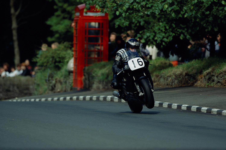 Robert Dunlop rides a JPS Norton at the Isle of Man TT