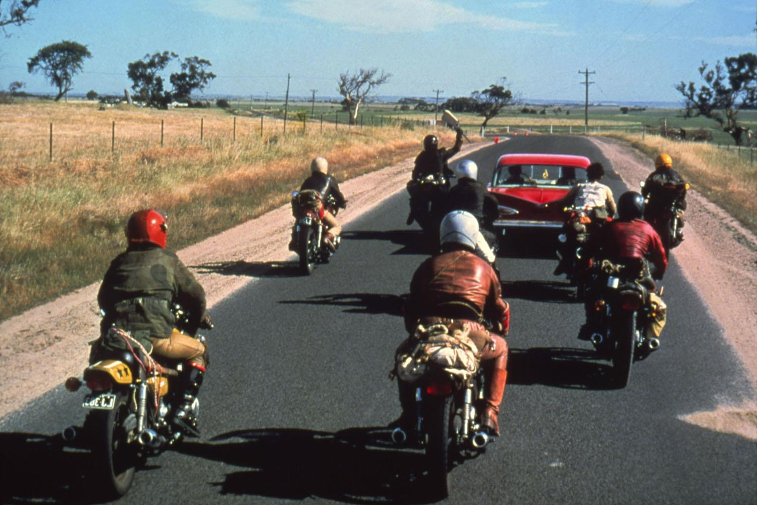 Gang members pursue a car in Mad Max
