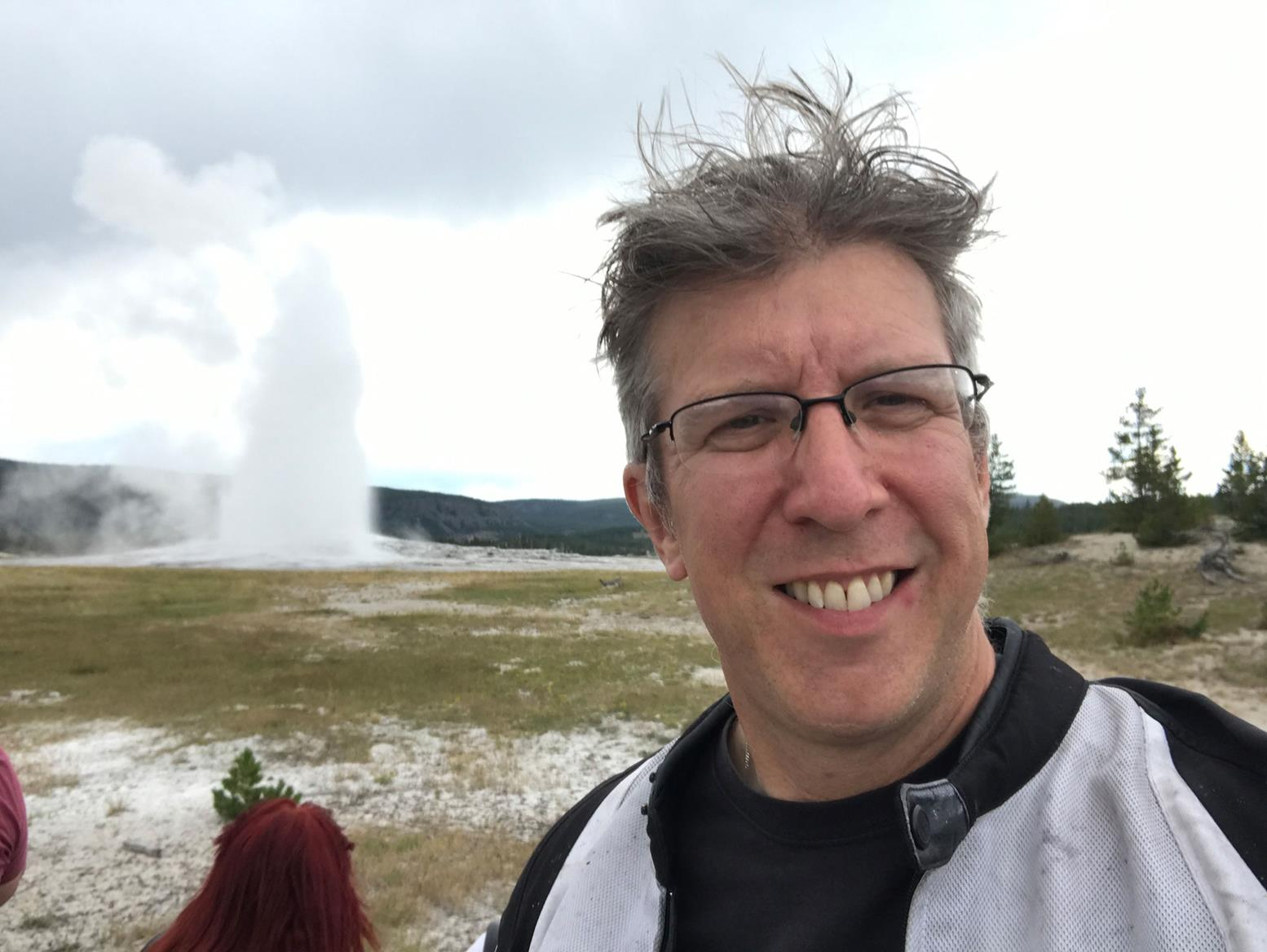 Simon in front of Old Faithful