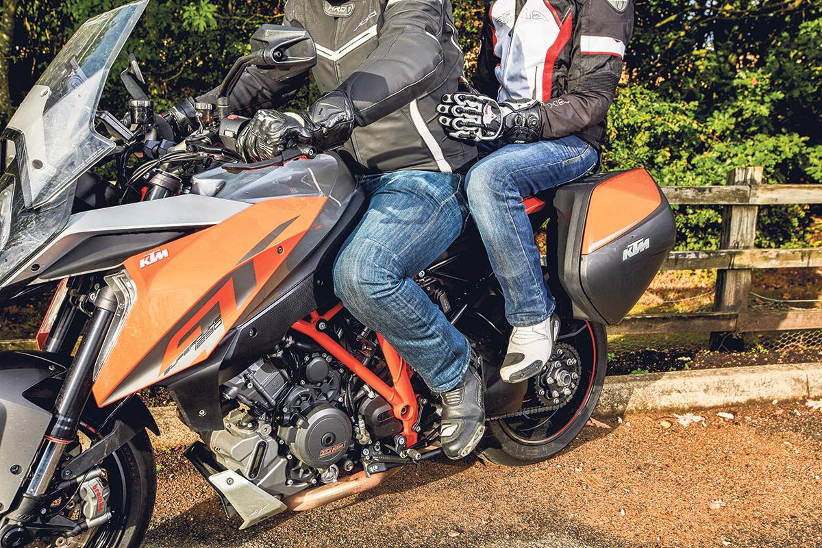 There are a couple of ways to hold on while riding pillion on a motorbike
