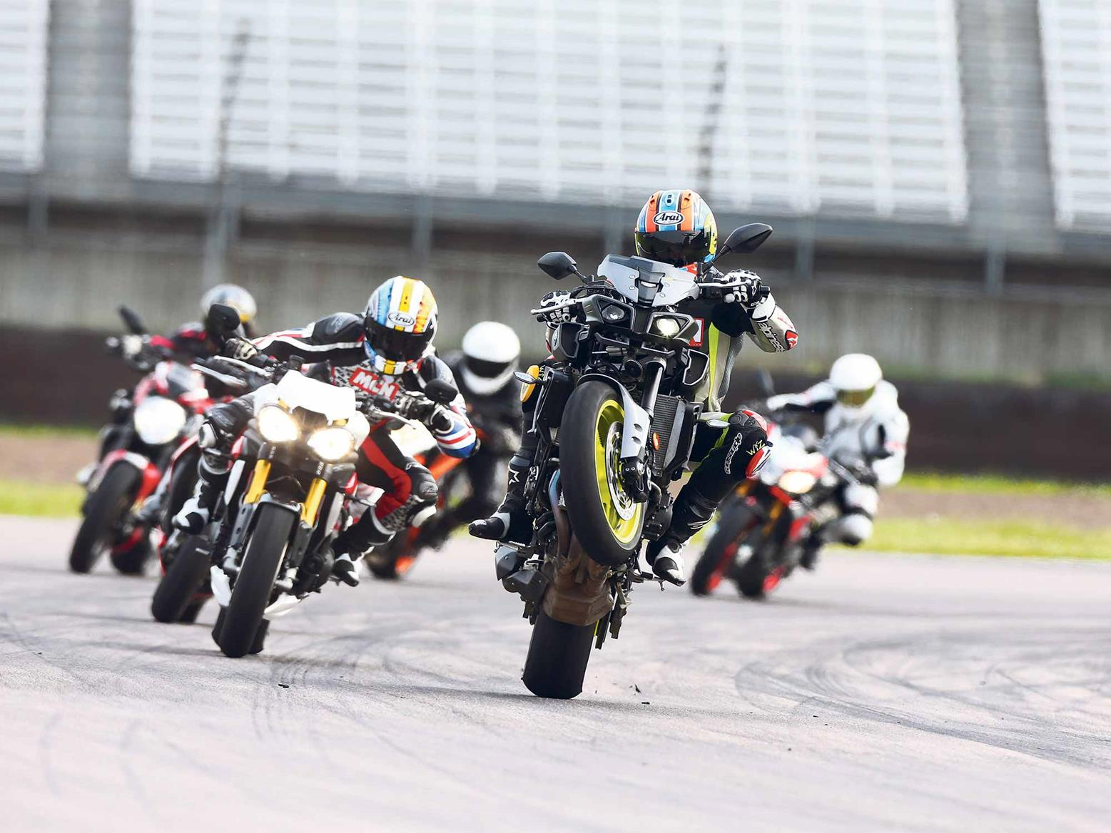 An MT-10 wheelies with its supernaked rivals