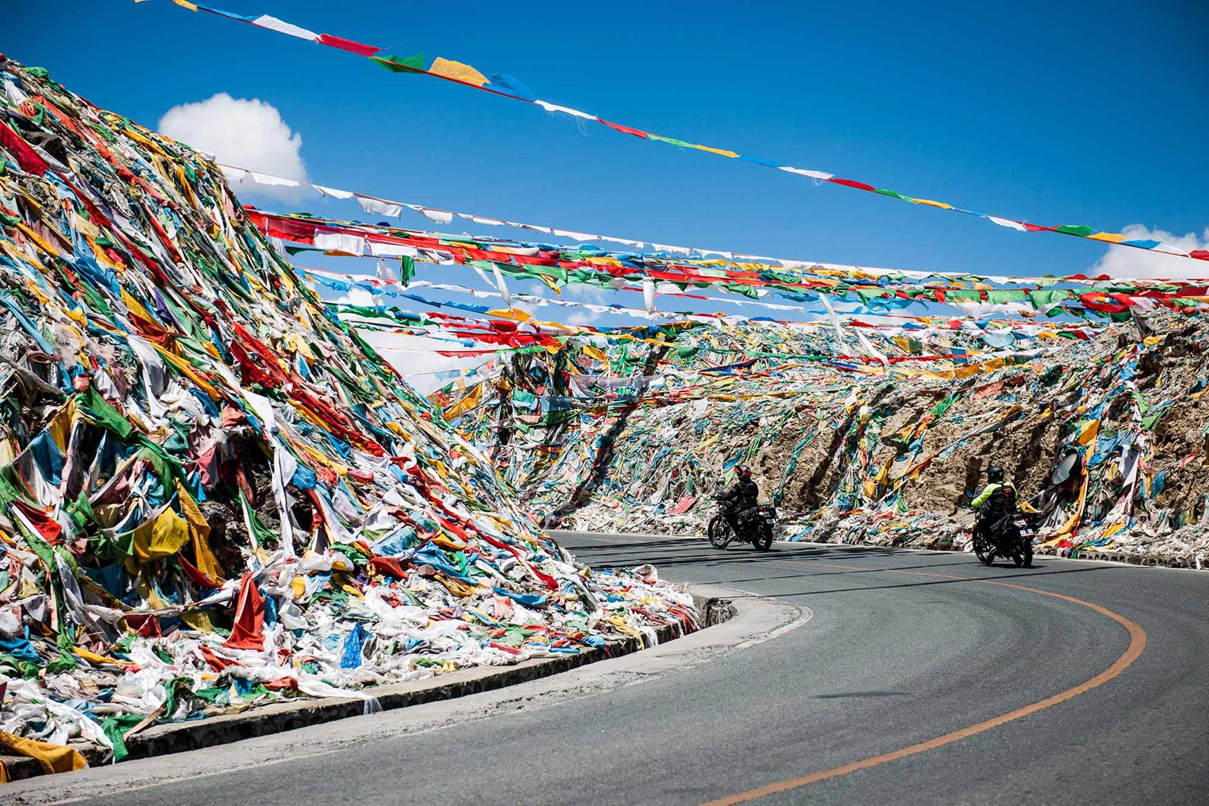 Prayer flags line the road