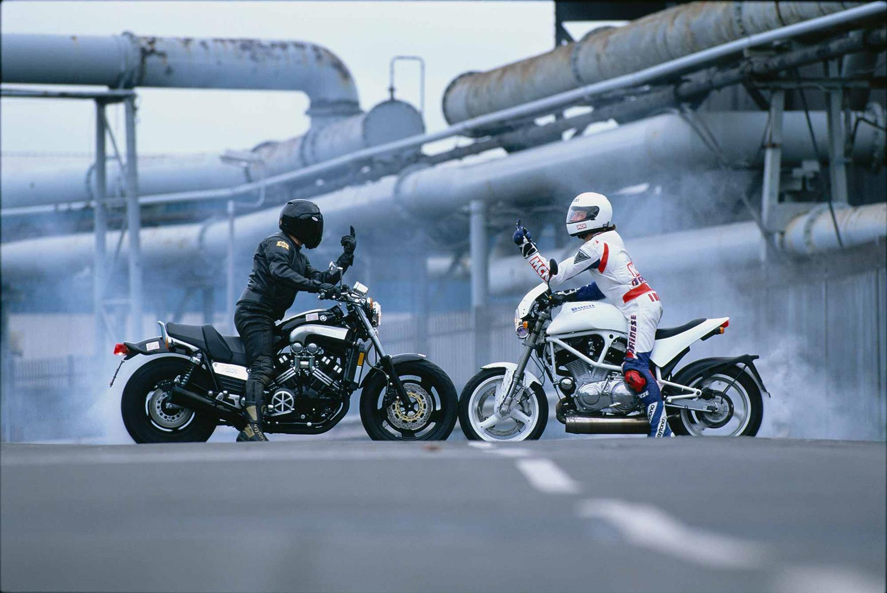 A Yamaha V-Max pulls a burnout with the Buell S1 White Lightning