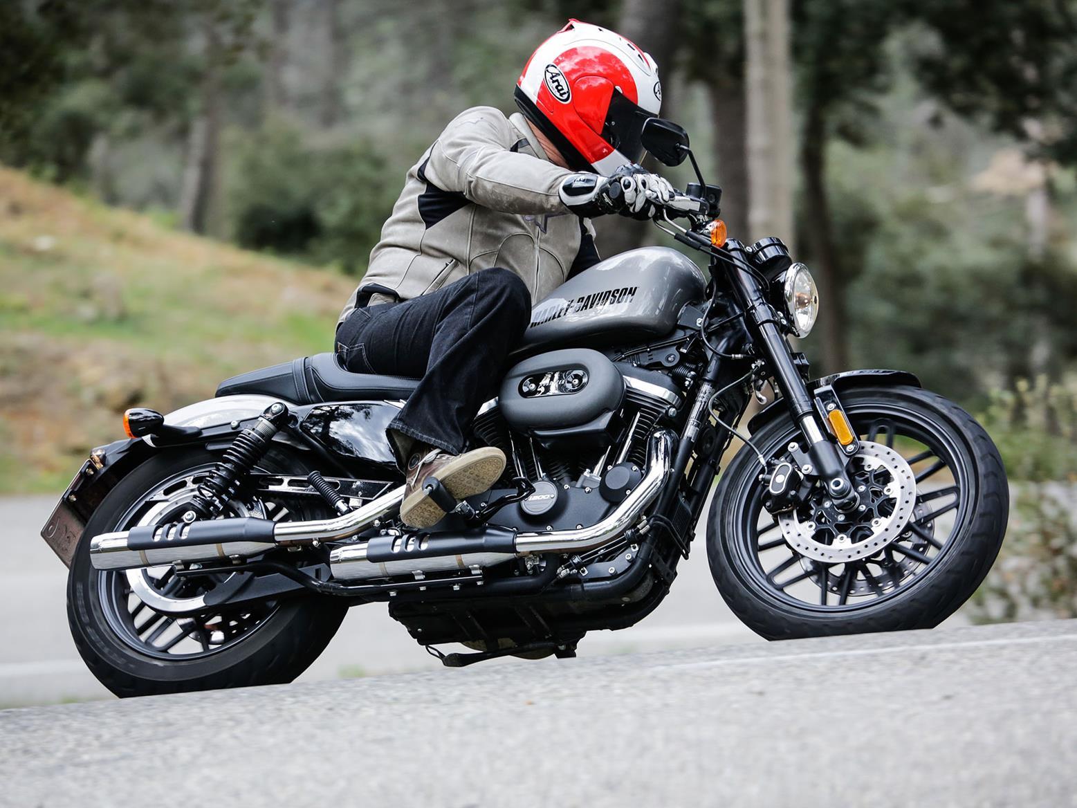 Harley-Davidson Roadster 1200 scraping a peg