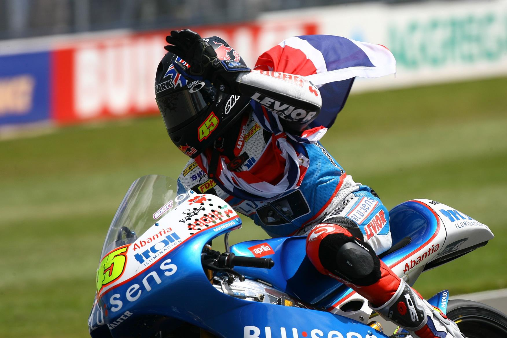 Scott Redding celebrates his 125 GP victory at Donington Park