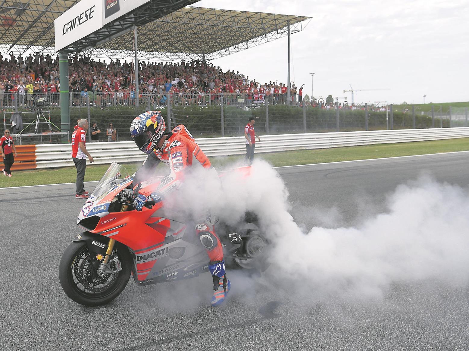 Andrea Dovizioso performs a burnout