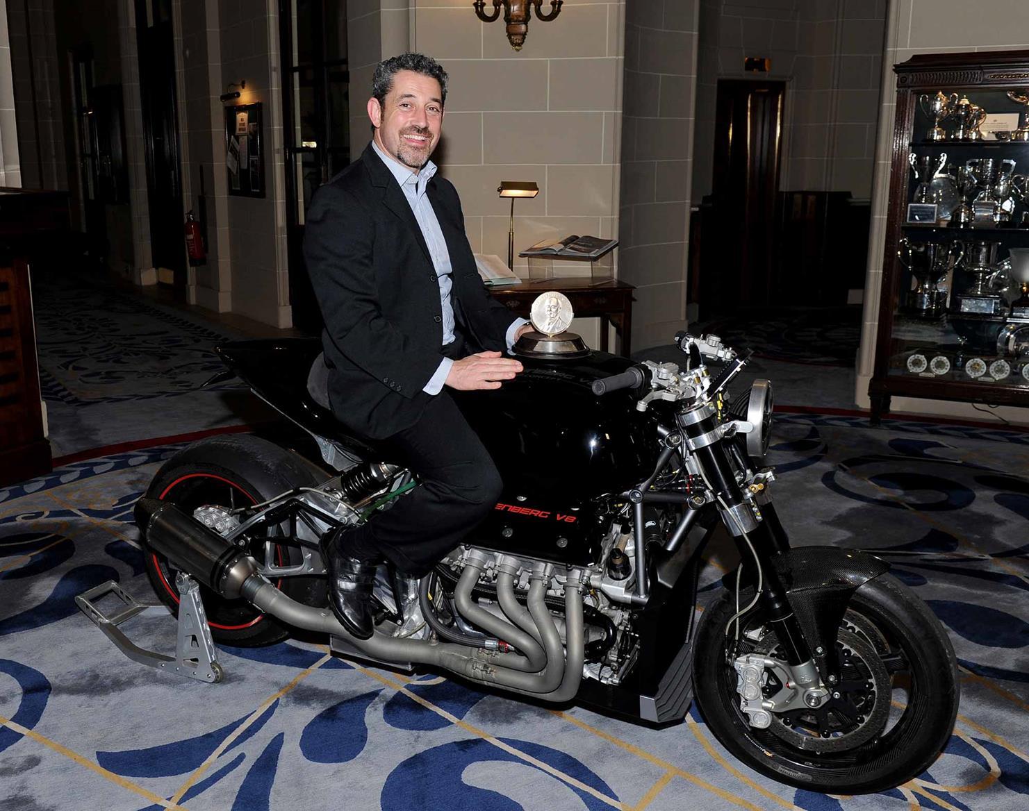 Eisenberg sits on his V8 motorcycle