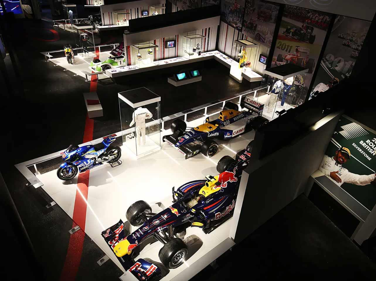 MotoGP bikes sit alongside Formula 1 cars