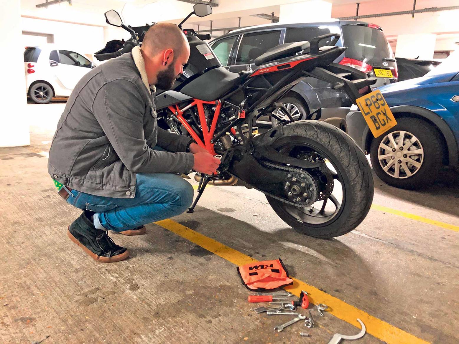 Adjusting the KTM's chain in a London carpark