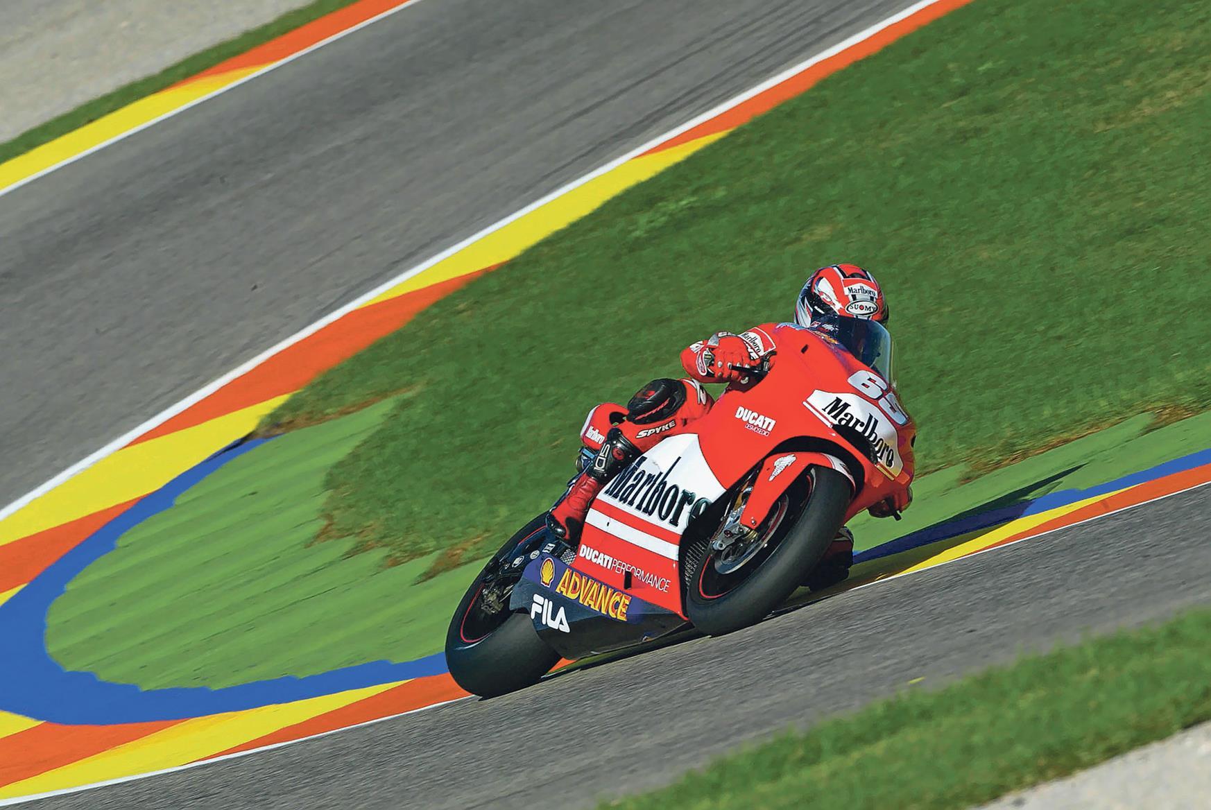 Loris Capirossi pilots Ducati's new MotoGP V4