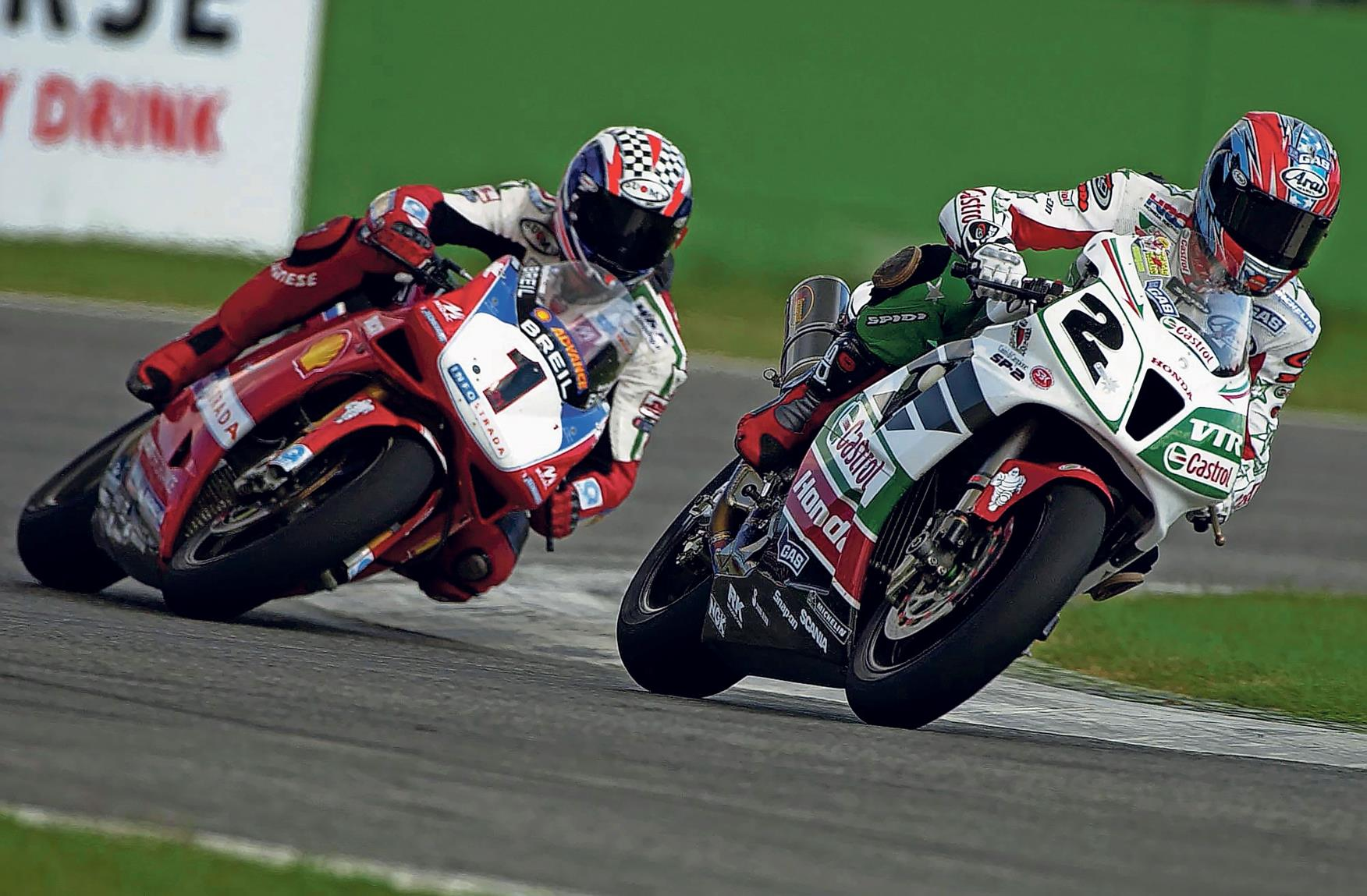 Colin Edwards and Troy Bayliss battle hard at Imola in 2002