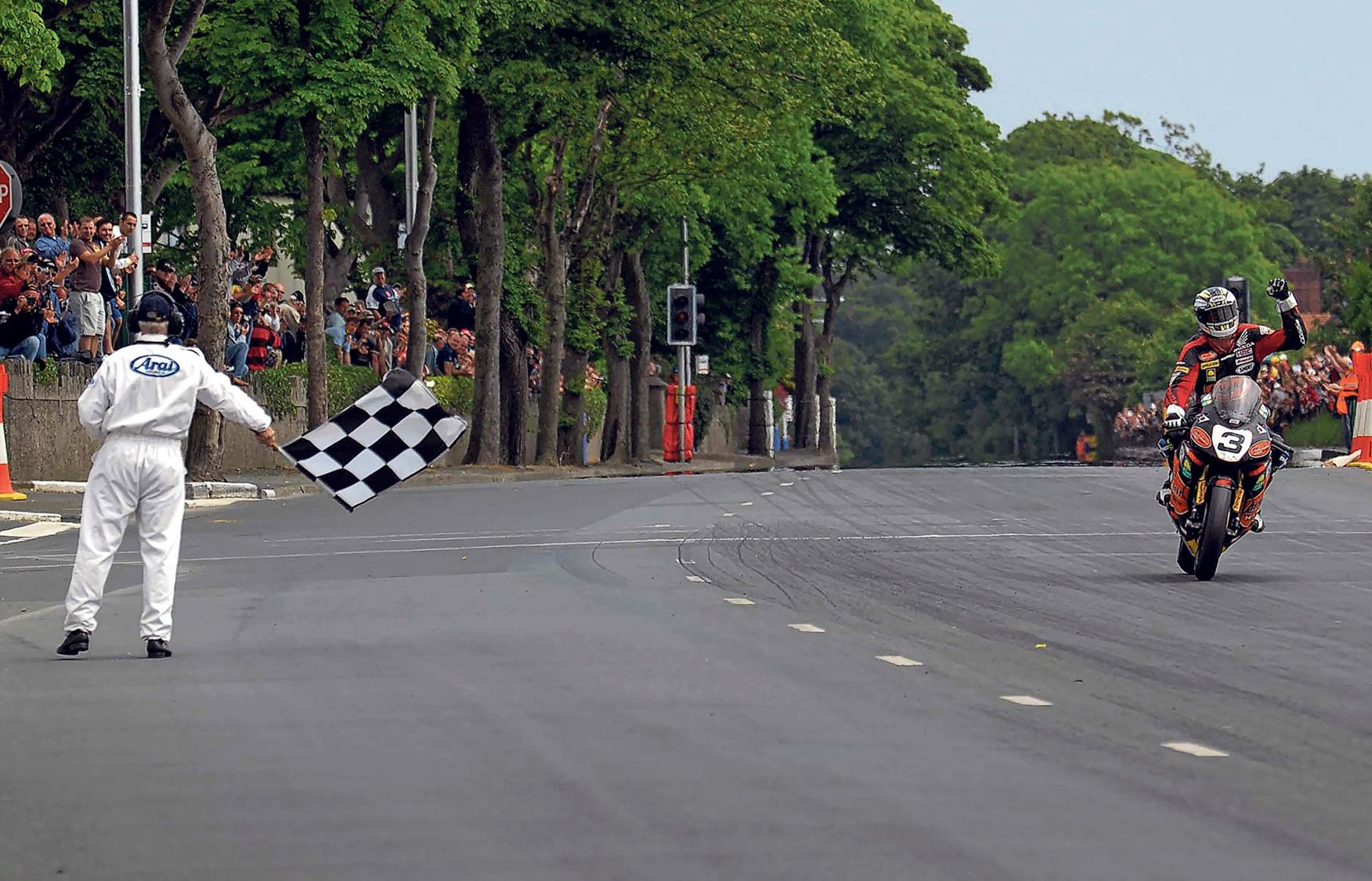 John McGuinness does the first 130mph TT lap