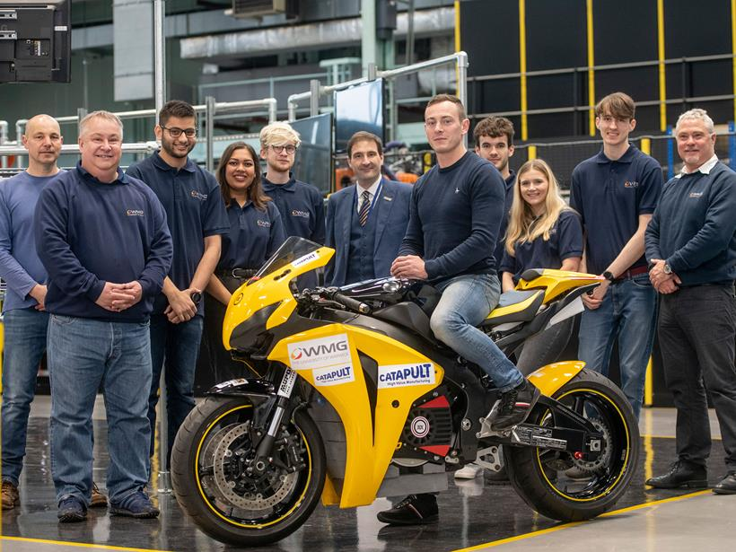 The Warwick Moto team pose with the bike before Covid